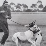 Darryl tries to control a pair of excitable greyhounds.